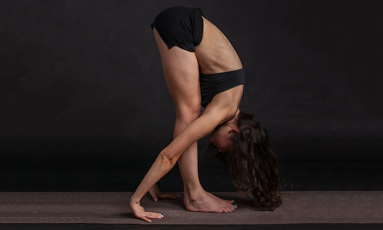 Bending down from a standing position for the back